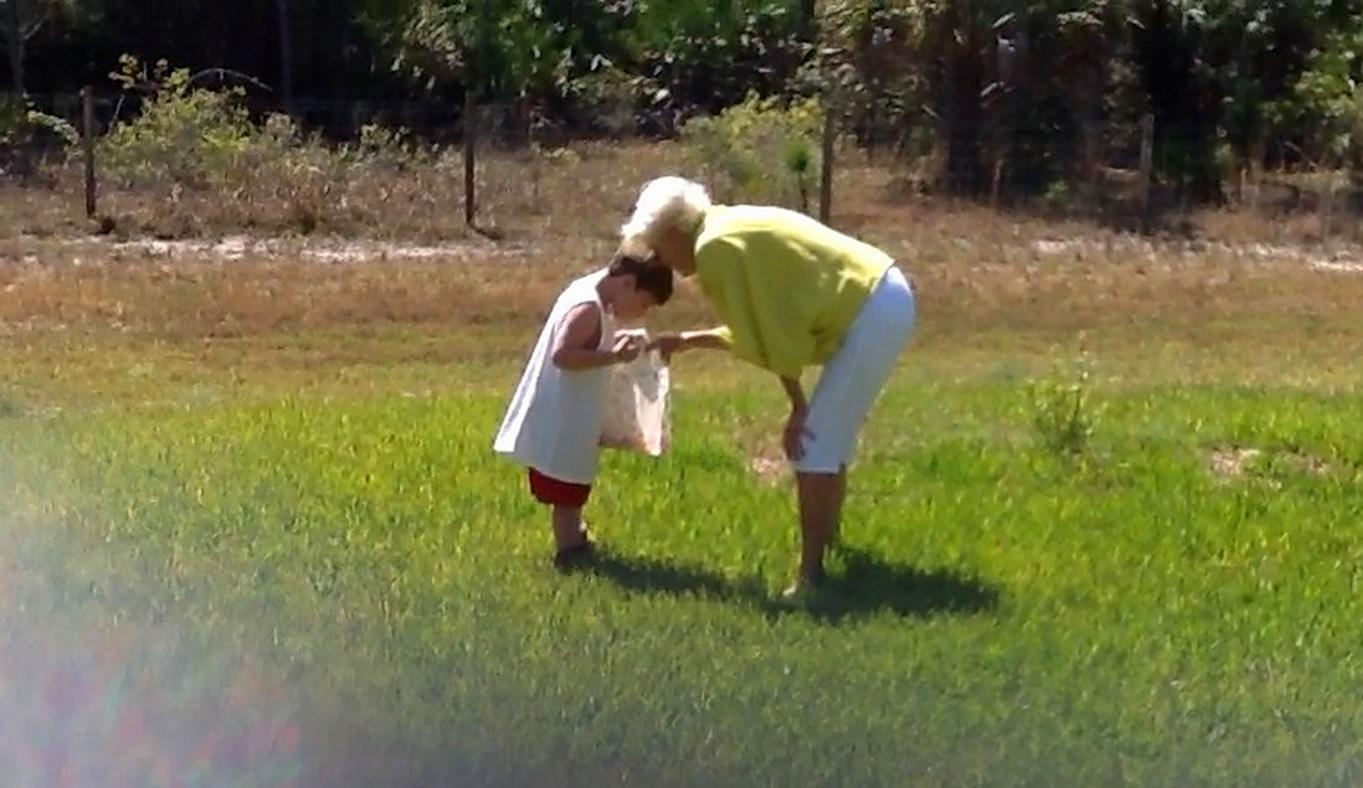 Free photograph; grandma, grandson, Easter, egg, hunting