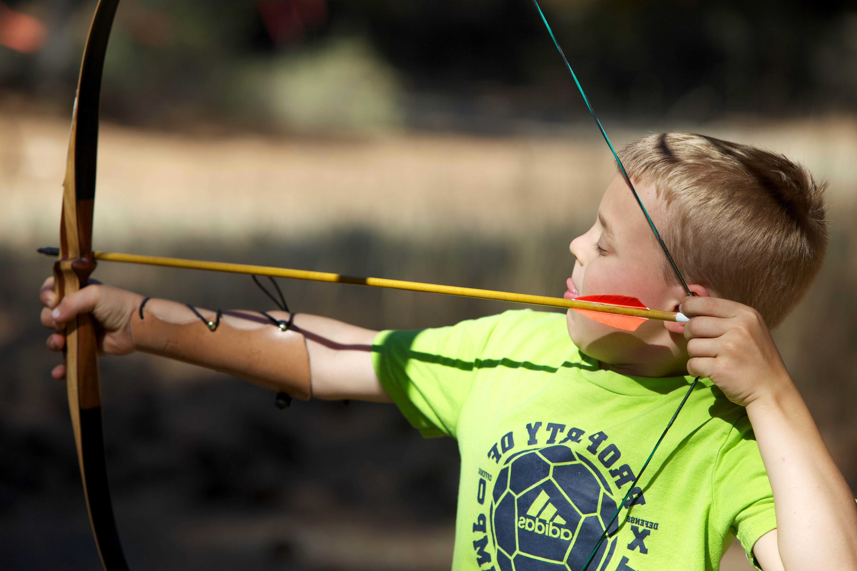 Free photograph; child, boy, bow, arrow