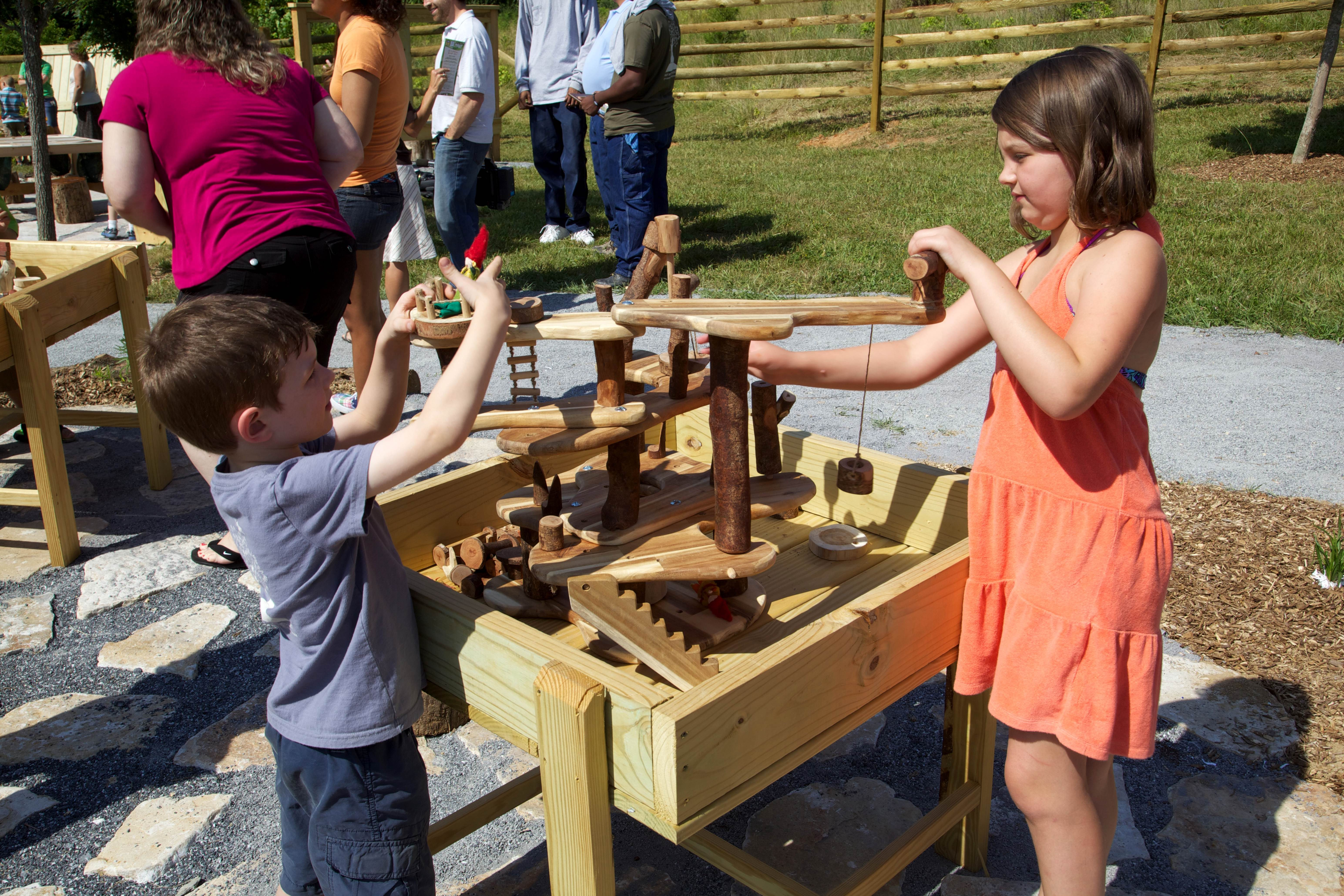 Free photograph; children, playing, outside, wooden, interactive, toy