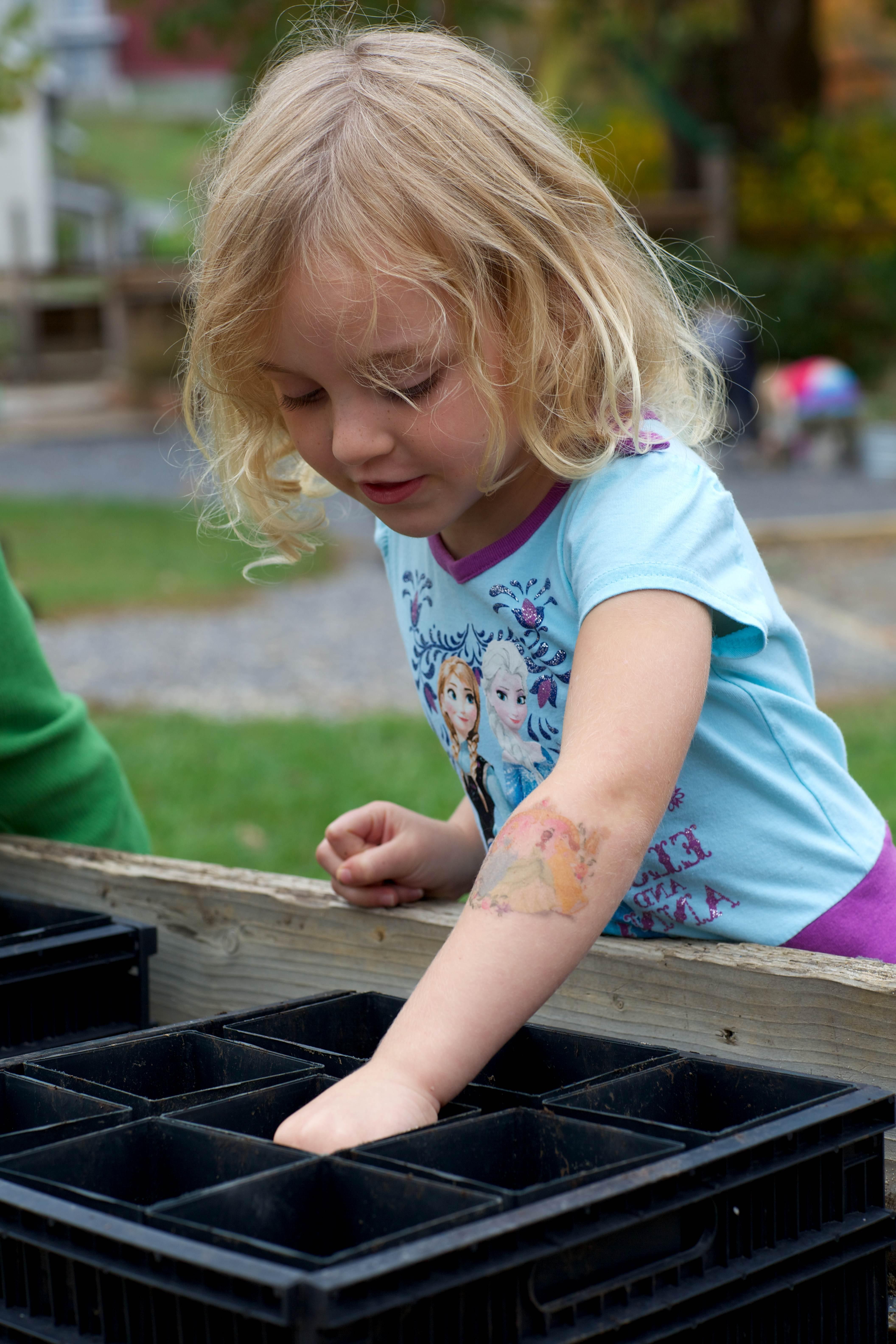 Free photograph; cute, blonde, girl, planting, seeds, pot
