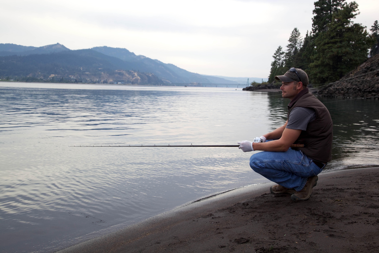 Free photograph; fisherman, fishing, river, shore