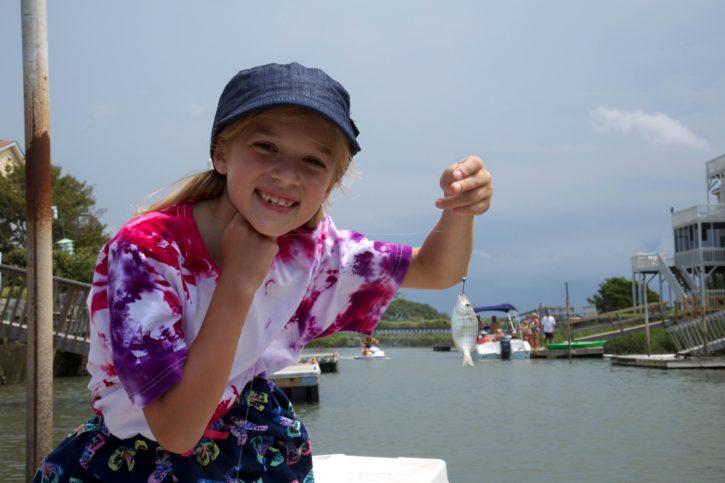 girl, holding, little, fish