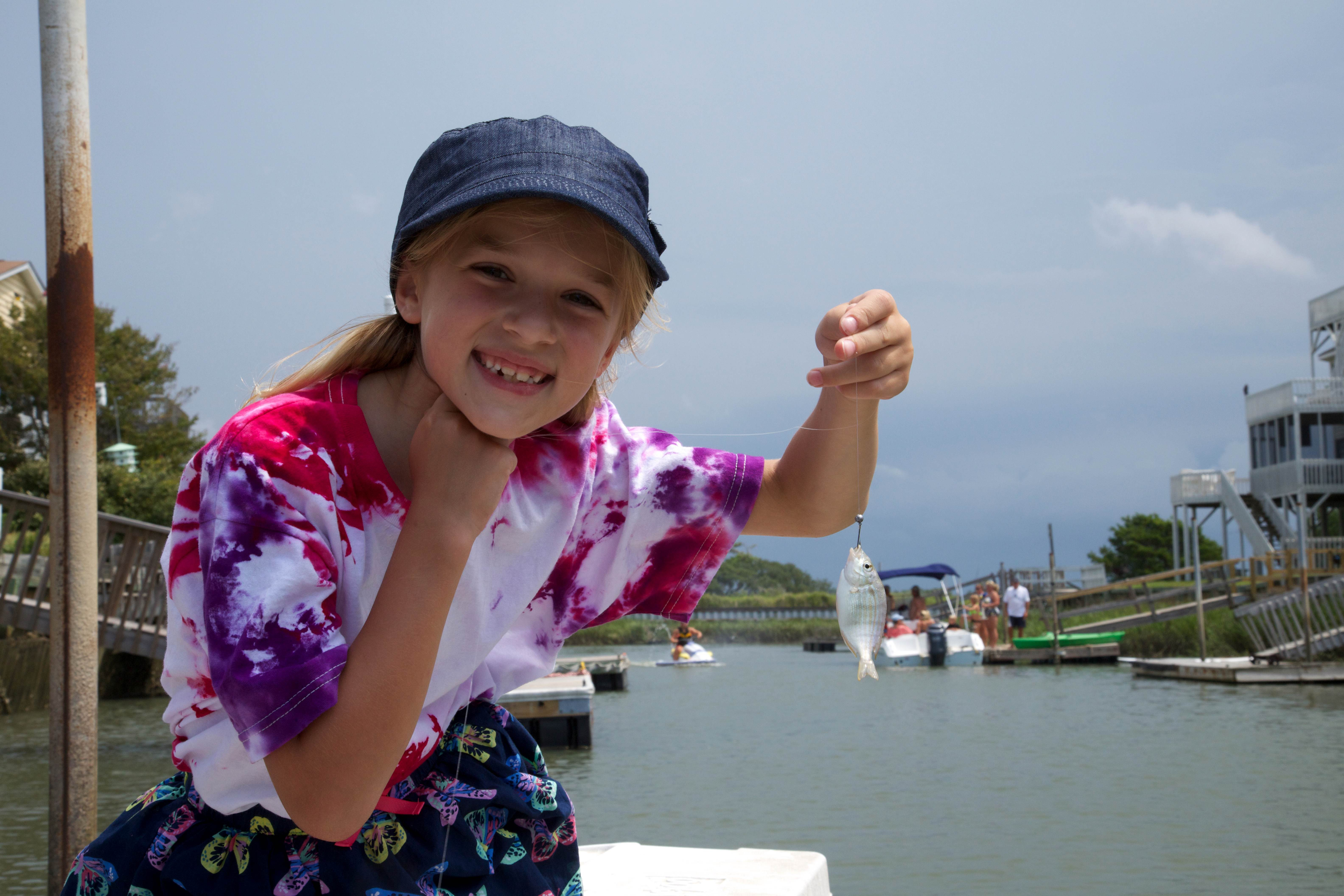 Free photograph; girl, holding, little, fish