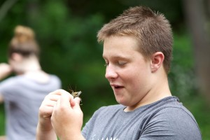 teen, boy, holds, crayfish