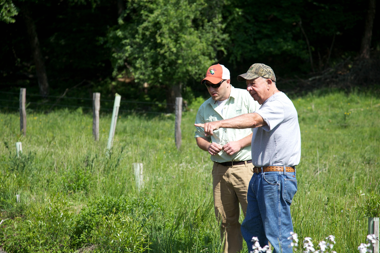 Free photograph; landowner, discussing, restoration, stream