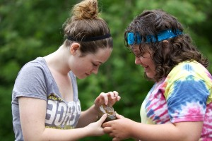 two, teen, girls, identify, macroinvertebrate