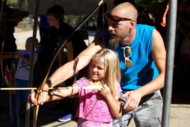 young, girl, shooting, bow, arrow