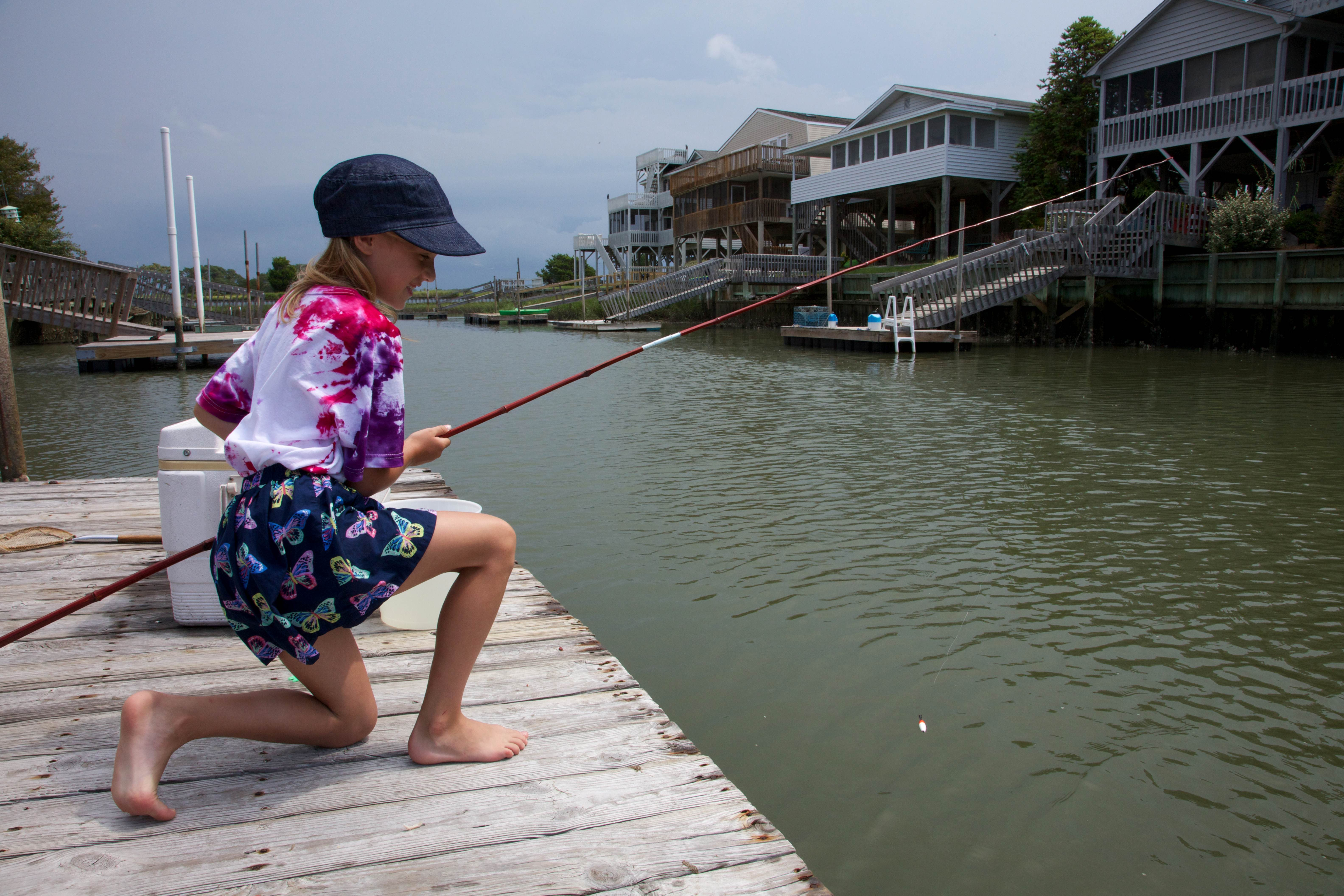 Free photograph; girl, fishing, dock, urban