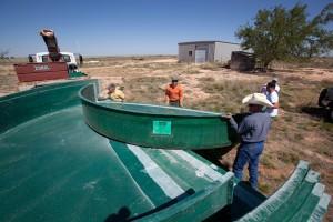people, work, livestock, watering, tanks