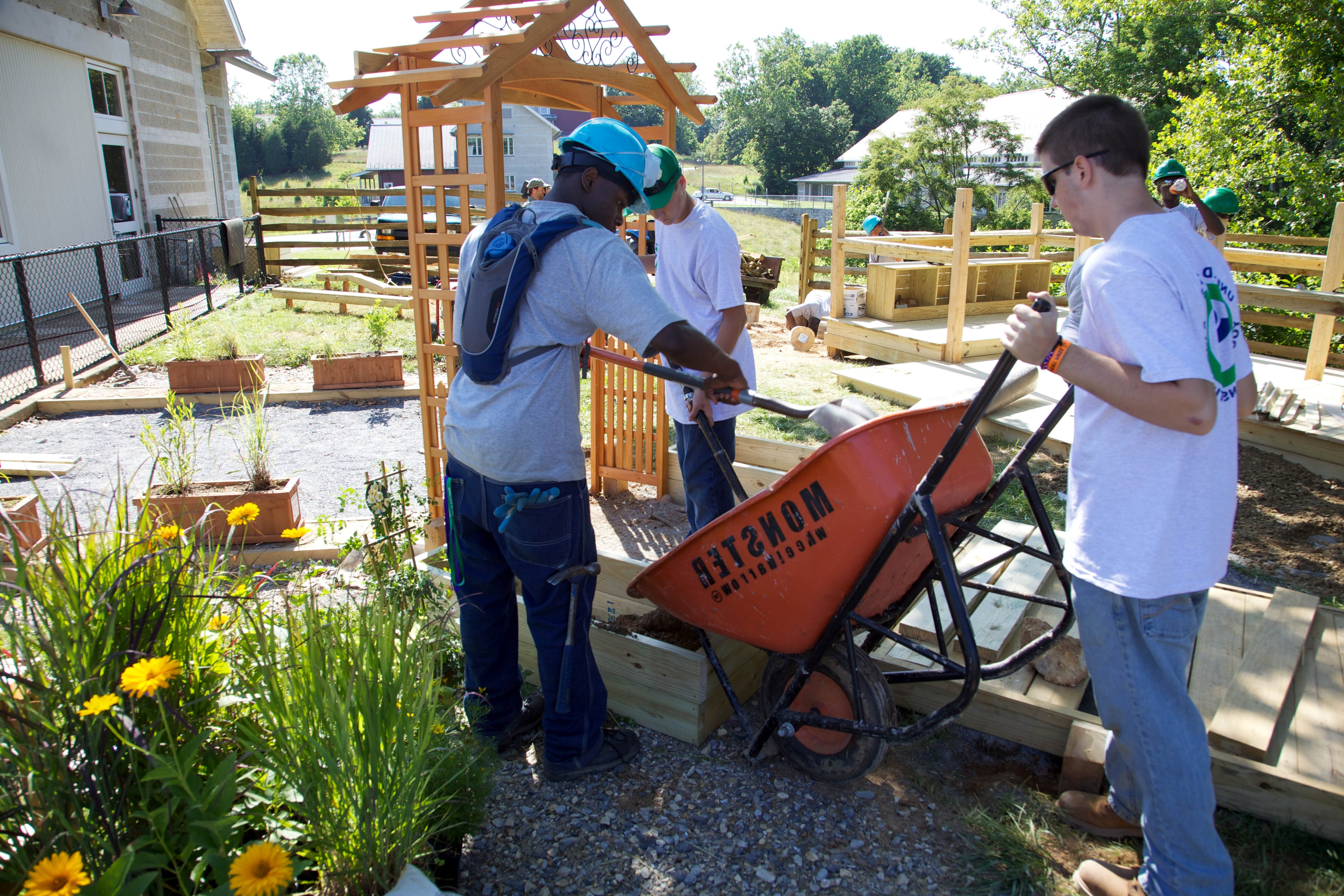 Free photograph; youth, workers, volunteers, filling, planter, box