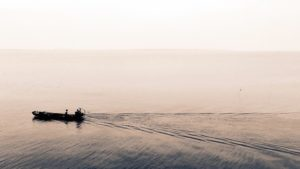 boat, fog, horizon, lake, man, mist, motorboat, ocean