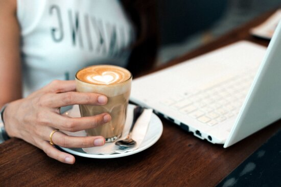 coffee cup, computer, paper, person, room, table, technology, woman