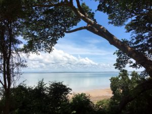 tropical island, lake, beach, calm clouds, daylight, tropical environment