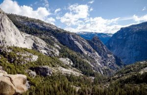 mountain peak, clouds, conifer trees, pine trees, rocks, sky, stones