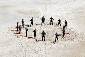 footprints, group, lifeguards, people, recreation, sand, seashore, training
