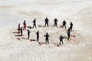 footprints, group, lifeguards, people, recreation, sand, seashore, training