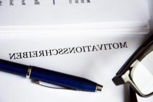backward reading, backward letters, business document, education, eyeglasses, paperwork
