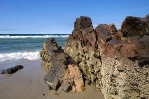 big rocks, tiny seashells, sand, coast, beach erosion