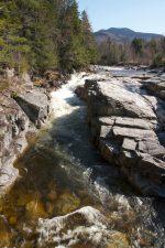 creek water, fast river, big rocks, river, rocks, trees, mountains