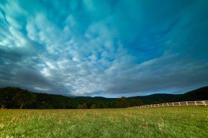 contrast, dark blue sky, night, grass, clouds, mountains
