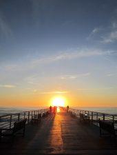 people, crowd, dock, sunset, ocean, sky, clouds