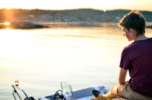 boy, lake, recreation, river, sitting, sunset, water