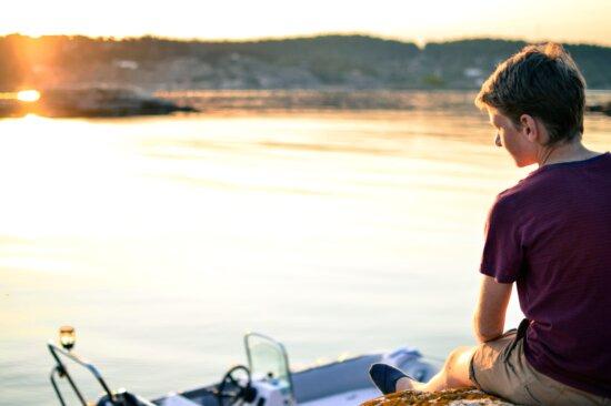 boy, lake, recreation, river, sitting, sunset, water