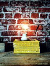 wooden surface, books, texture, bricks, wall lamp, light bulb