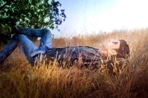boy, laying down, Sun, looking up, grass