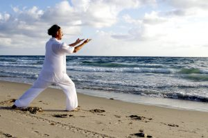 man, white, praticing tai chi, beach