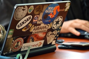 laptop computer, stickers, table, technology