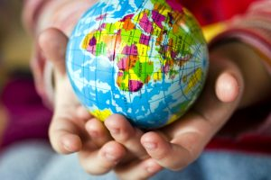 hands, small globe, earth