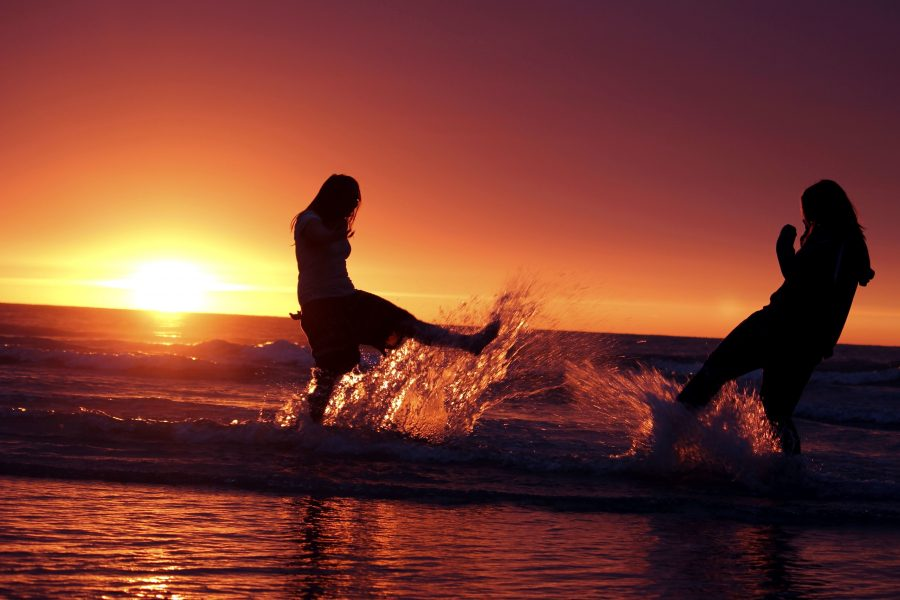 two girls, sunset, water