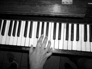 hand playing piano, music