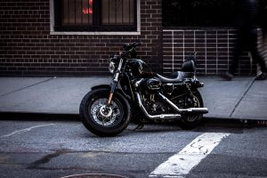 motorcycle, parked outside, street