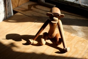 wooden toy, monkey, sunbeam, shadow