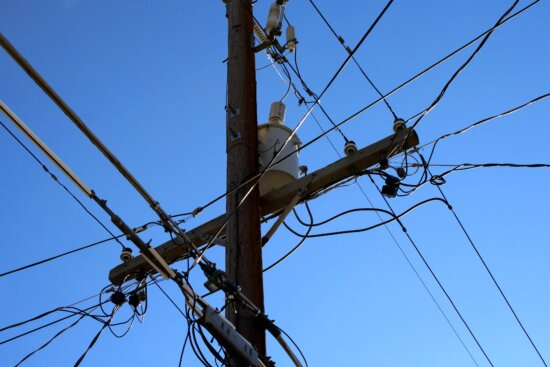 telephone pole, phone wires, power lines