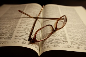 reading glasses, pages, dictionary book