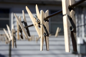 wooden clothespins, wooden clips, wire