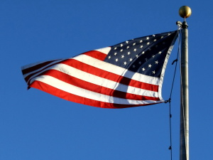 American flag, wind, blue sky