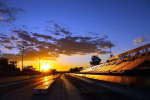 road, sunset, asphalt, bleachers, city, clouds