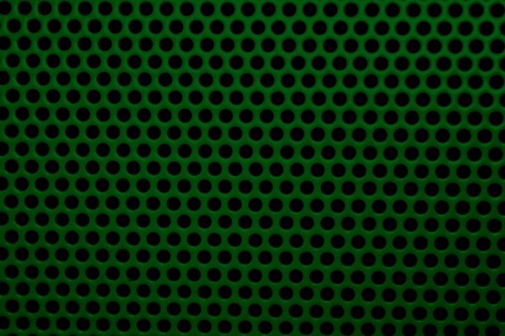 couleur vert foncé, un treillis métallique, des trous ronds, texture