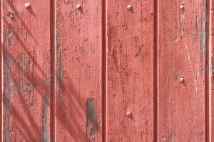 old wood fence, peeling red paint, wooden planks, texture