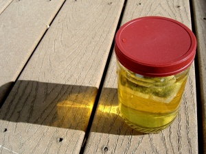 Sun, tea , glass jar