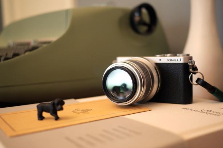 antique photo camera, papers, analog camera