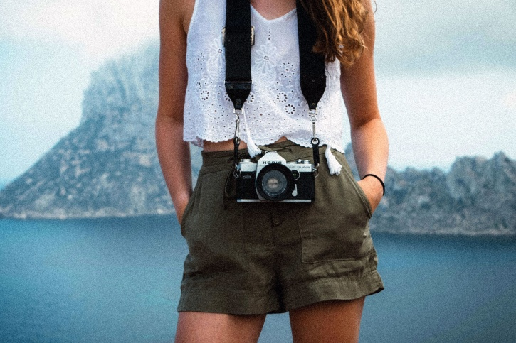 short pants, old camera, woman, strap, water