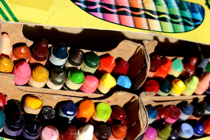 colorful crayons, carton box