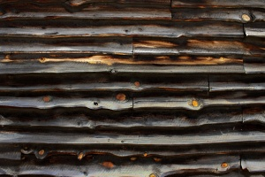 old barn, wooden planks, dark brown color, texture, wooden knots