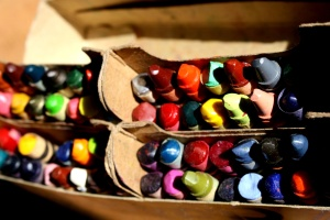 colorful crayons, old carton box