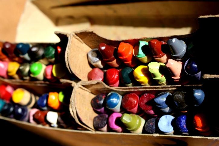 colorful crayons, old carton box
